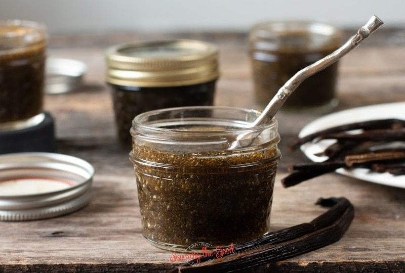 vanilla bean paste in a 4 ounce glass jar with a spoon in the jar