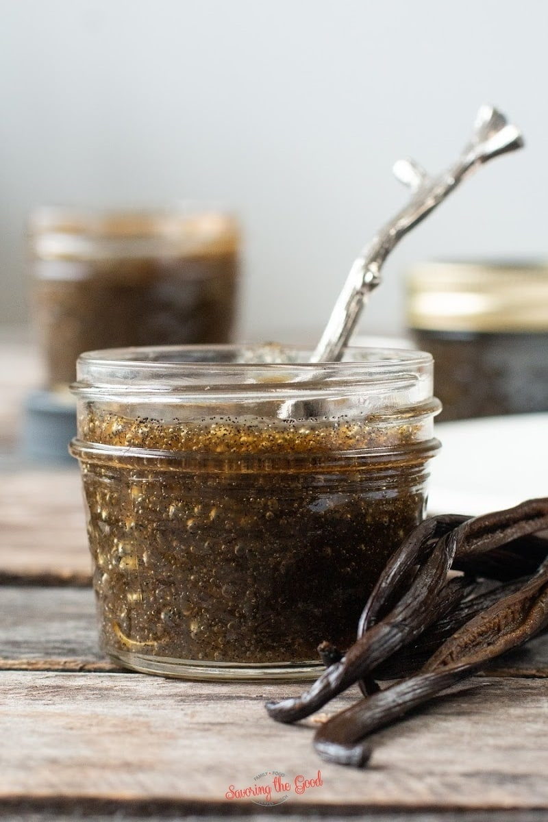 vanilla bean paste in a small glass jar with spoon