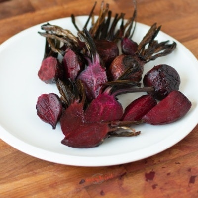 roasted whole beets on a plate