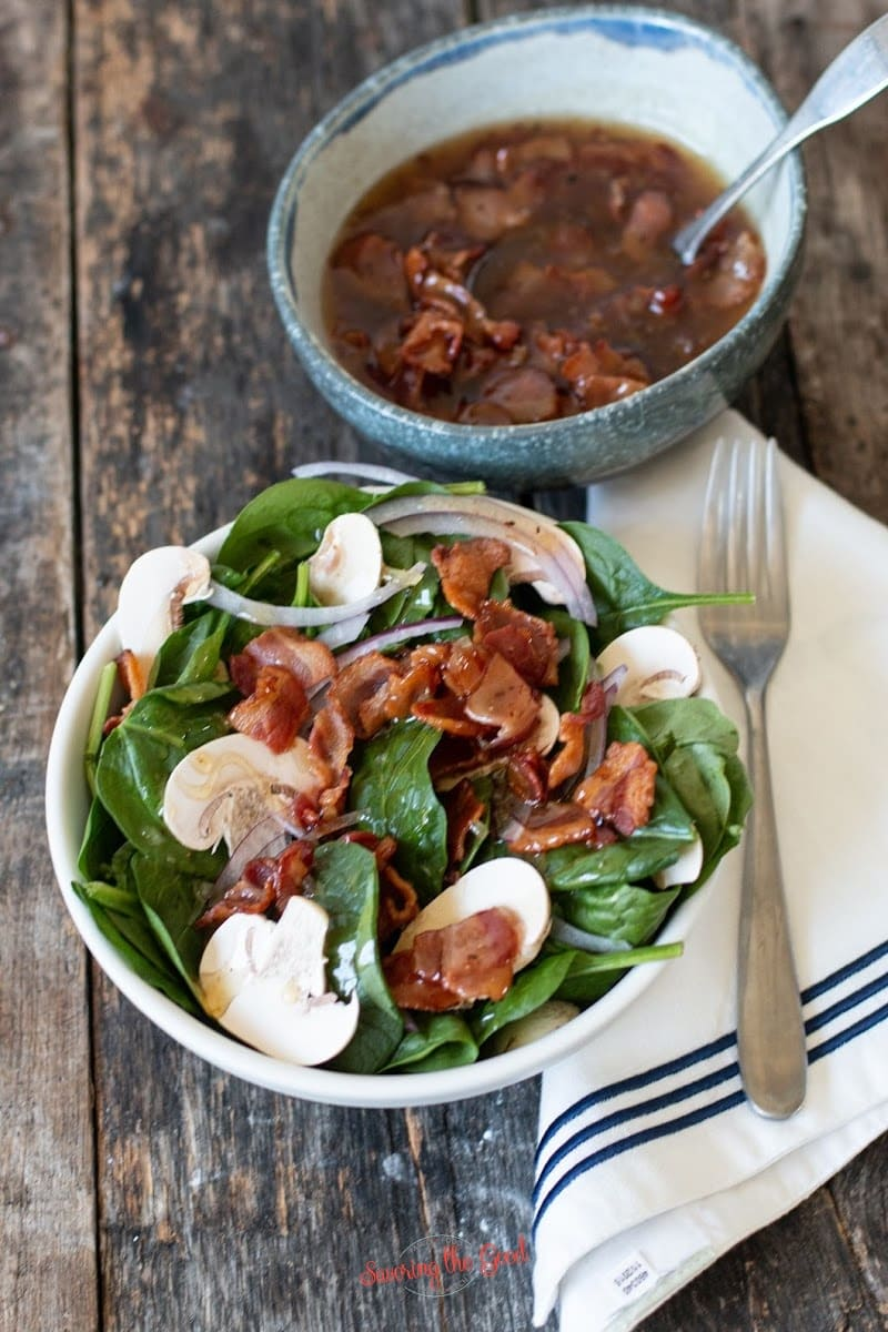 Hot Bacon Dressing with a bowl of dressing to the top