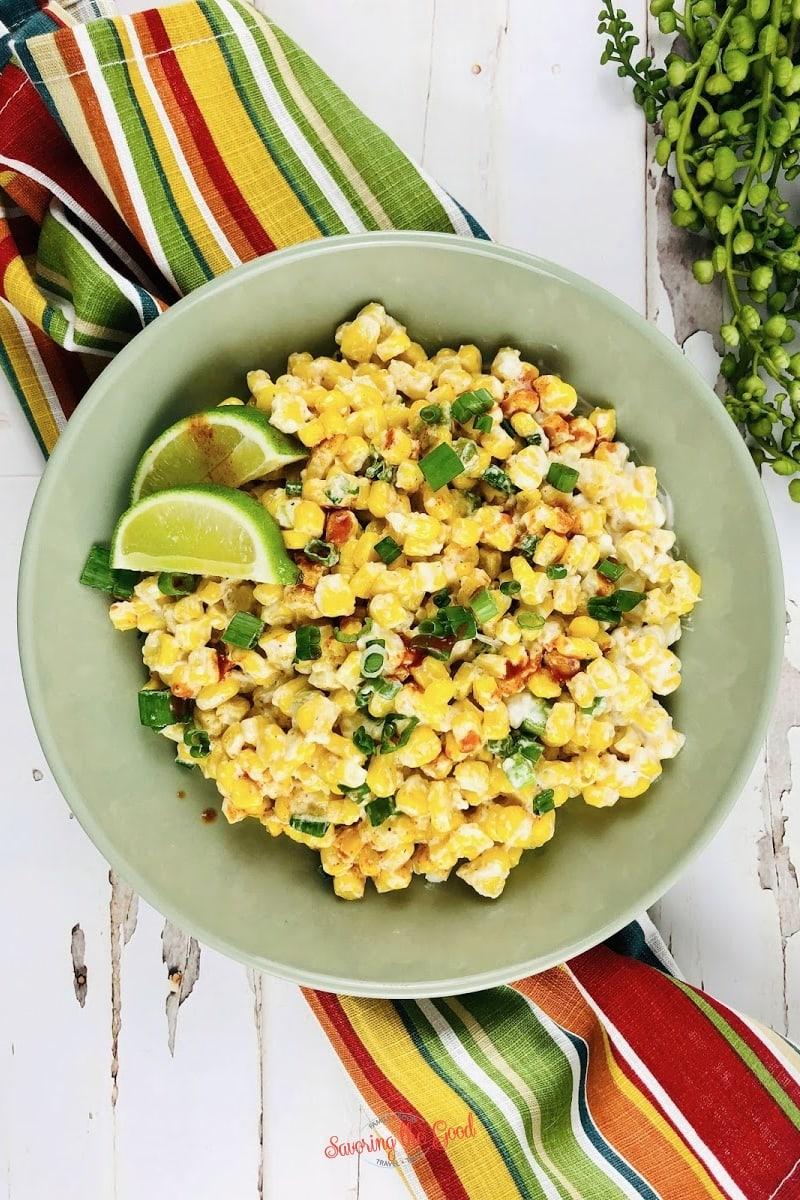Mexican corn casserole recipe in a green bowl