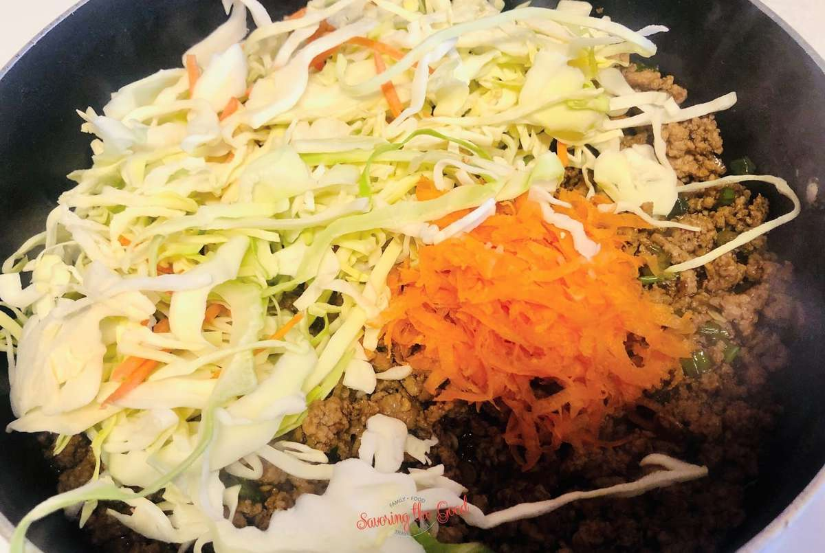adding the cabbage and carrot to the WW Egg Roll In A Bowl Recipe