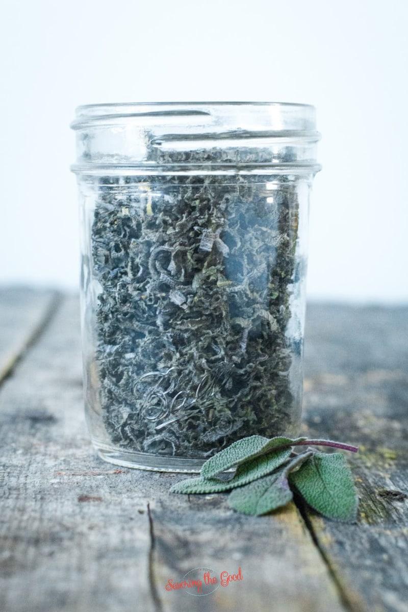 dried sage in a clear glass jar