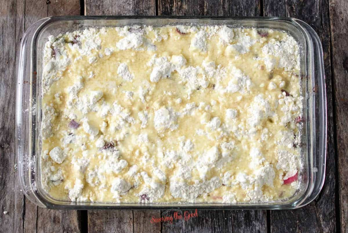 butter poured over the dump cake before baking