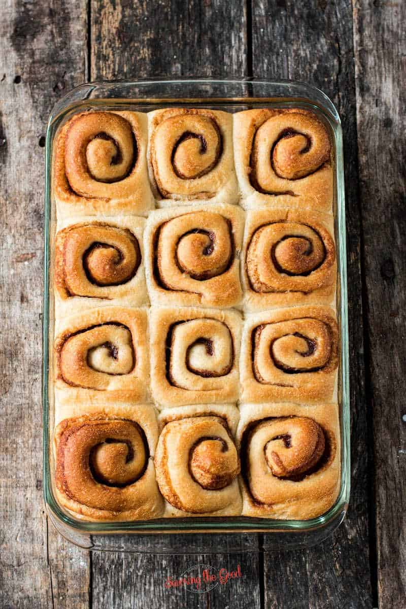 9 by 13 glass pan with baked Rhodes Cinnamon Rolls in it