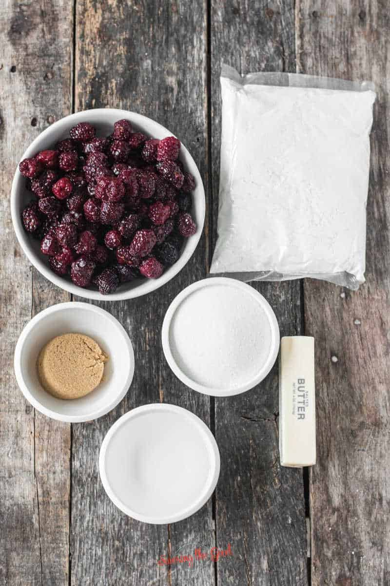 Blackberry Dump Cake ingredients on a wooden surface
