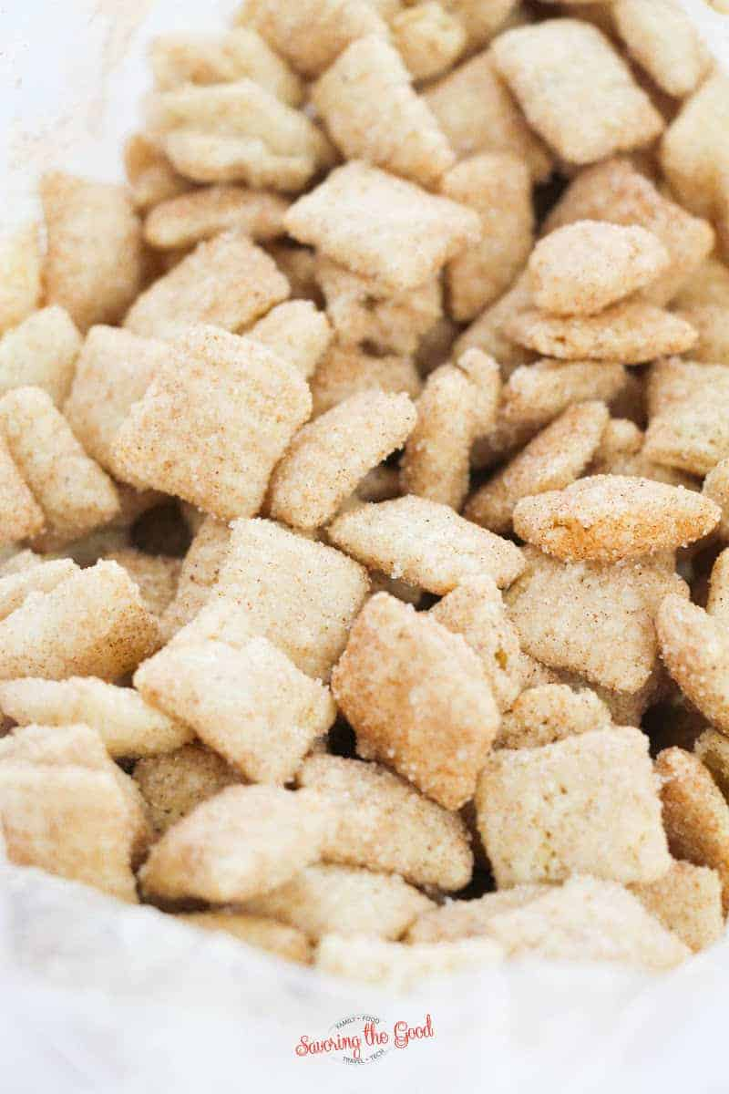 Snickerdoodle muddy buddies just shaken in a zip top bag with cinnamon and sugar