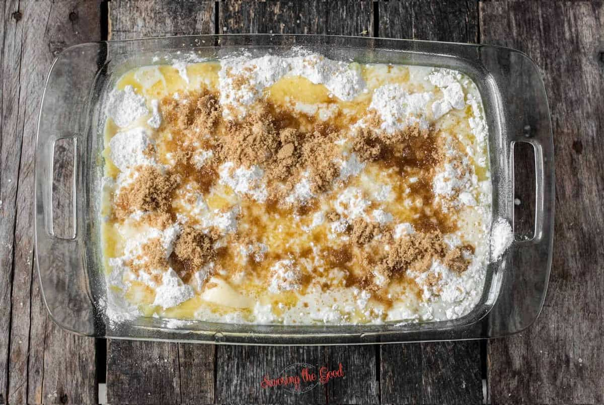 adding brownsugar to Pineapple Dump Cake before baking