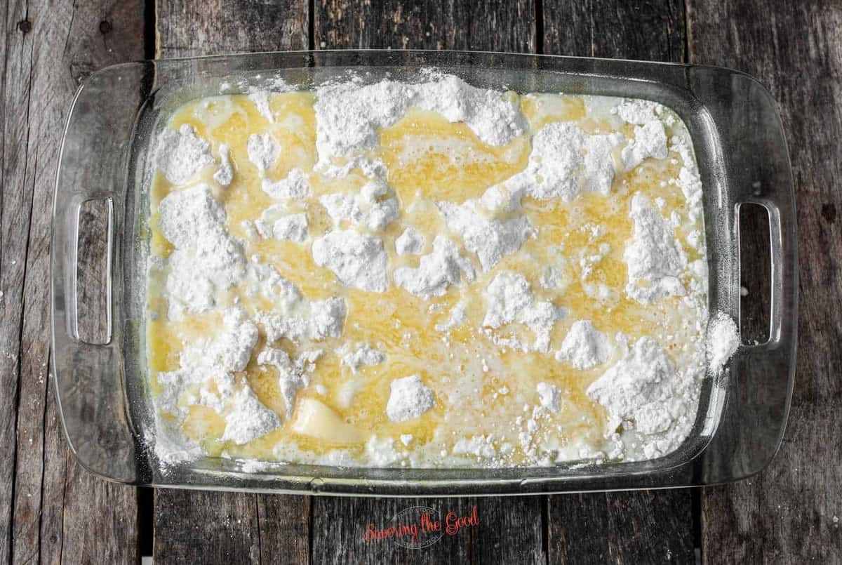 adding melted butter to Pineapple Dump Cake before baking
