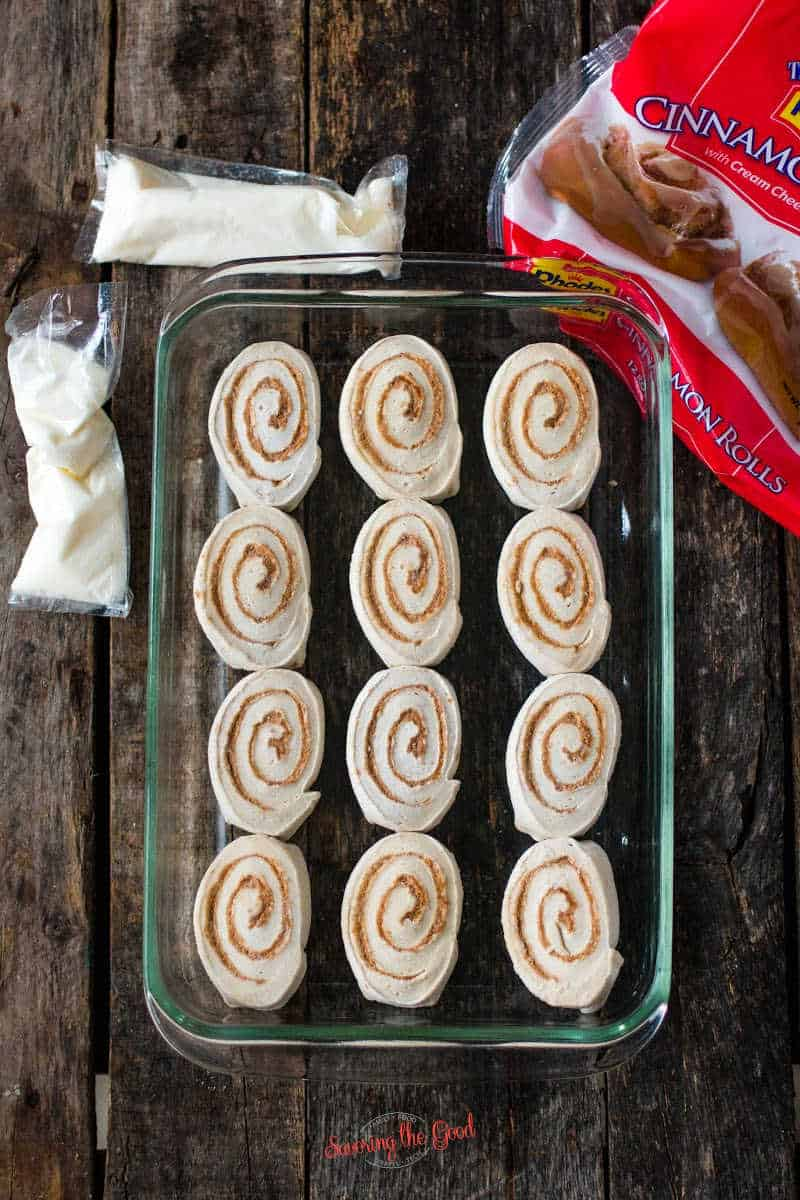 frozen Rhodes Cinnamon Rolls in a pan with the icing bags off to the side