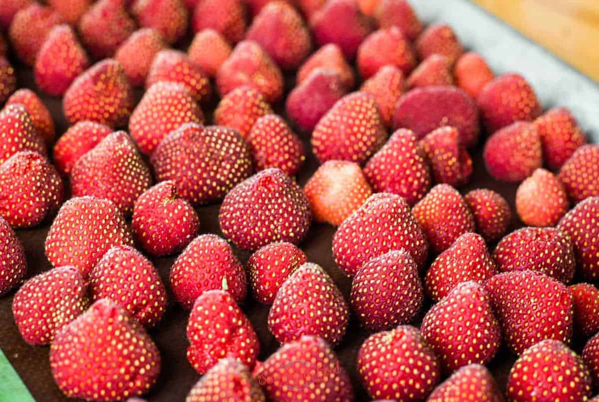 frozen strawberries whole on a tray