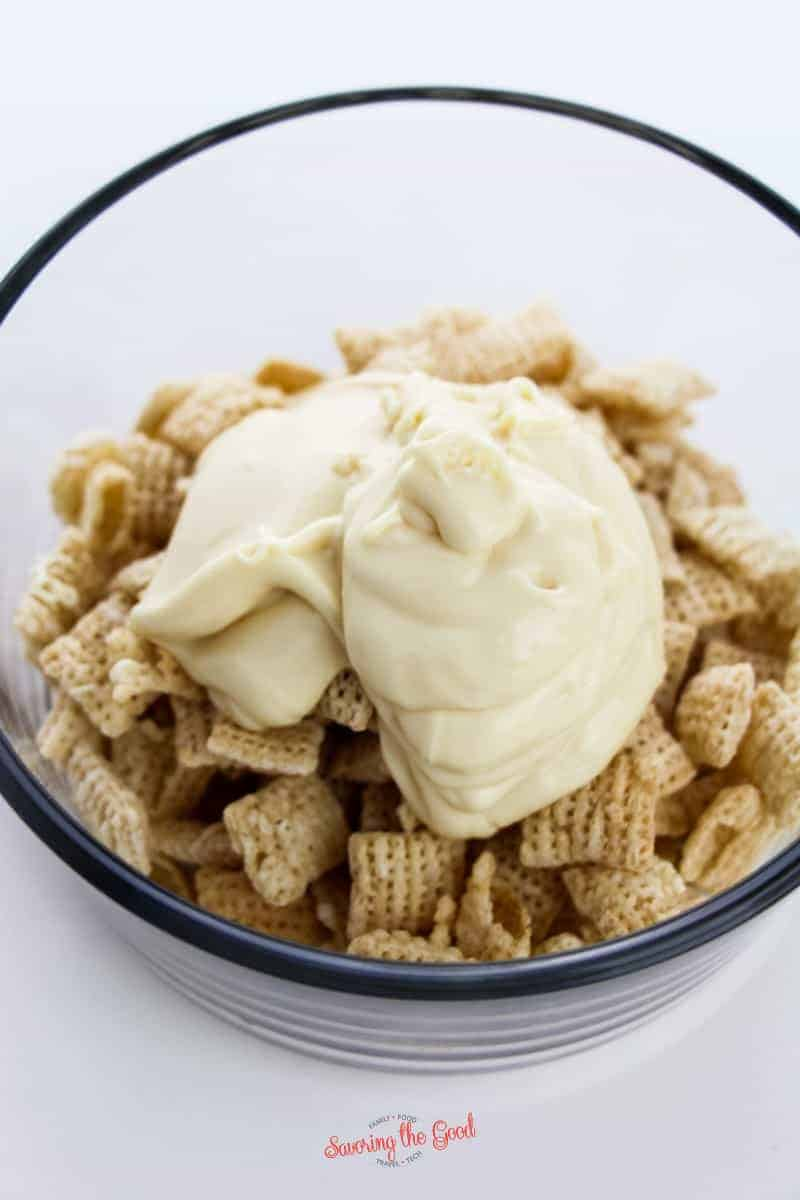 white chocoalte on top of rice chex cereal, reasy to be combined