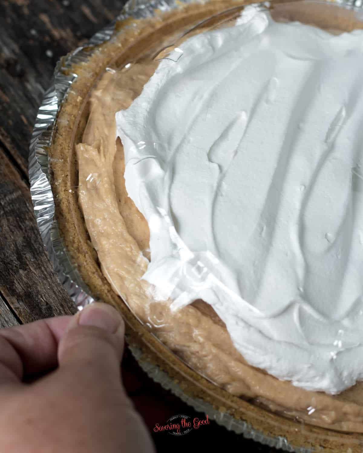 showing how to put back the plastic lid on the graham cracker crust
