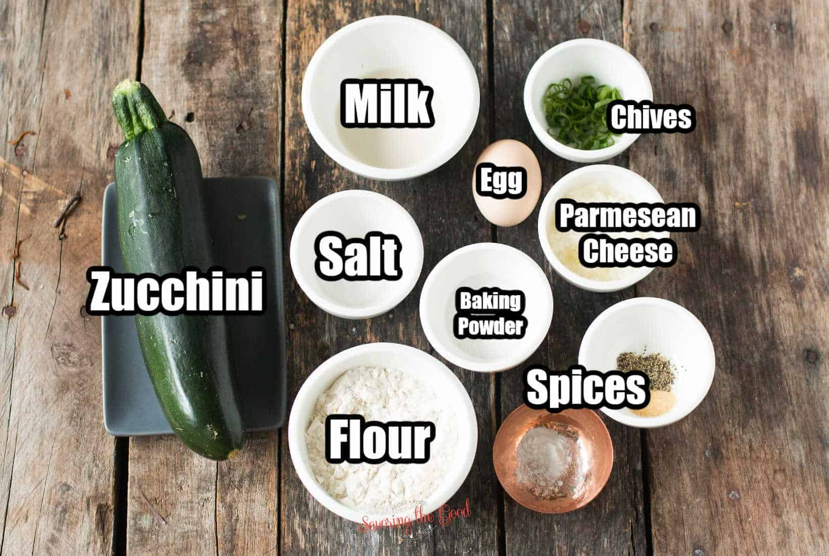 zucchini fritters ingredients in bowls with text labeling them