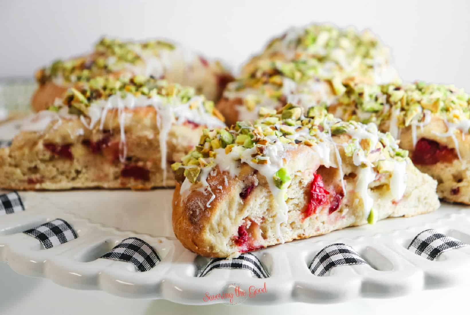 5 Cherry Scones with garnishes on a white plate