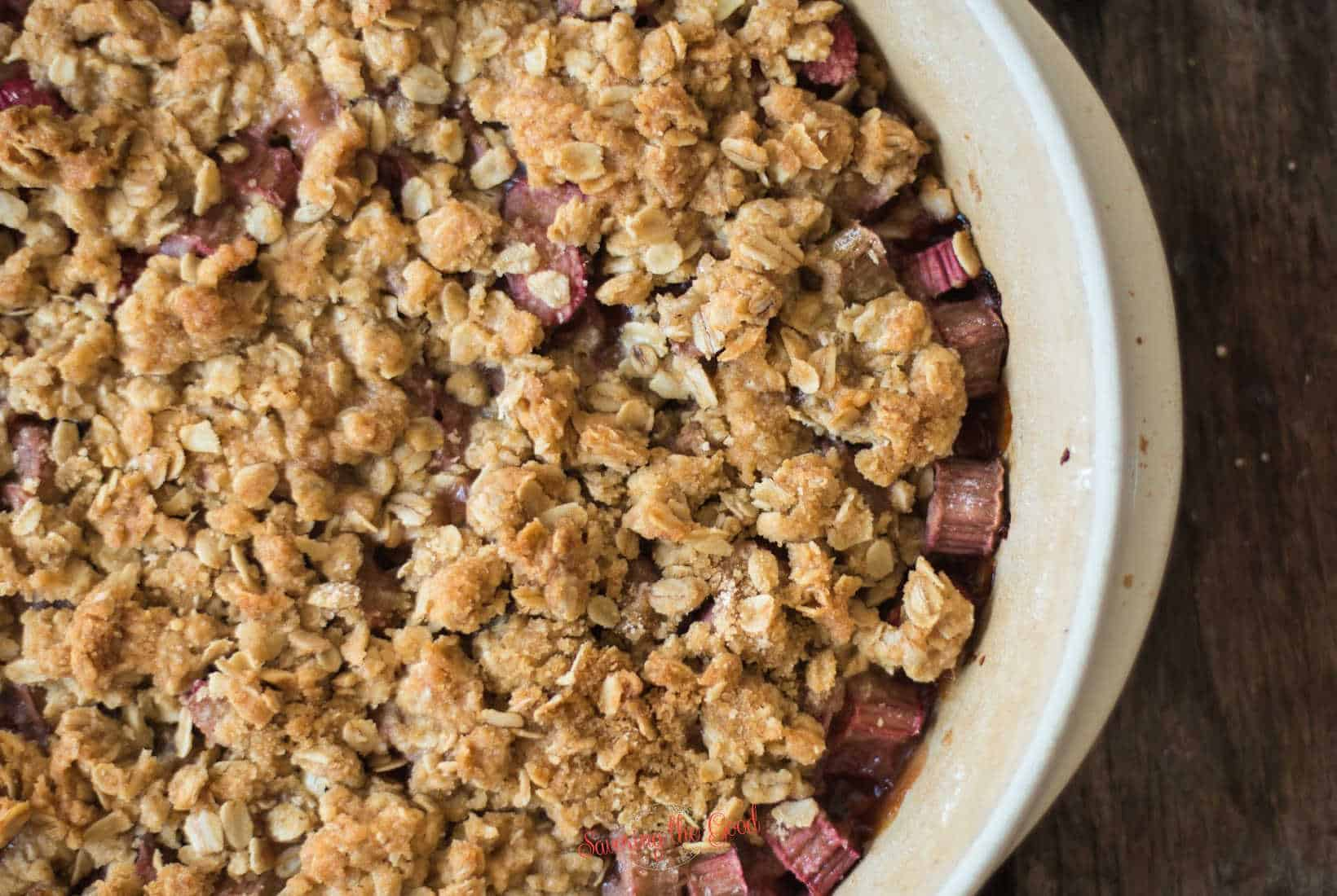 freshly baked Rhubarb Crumble in a stoneware serving dish