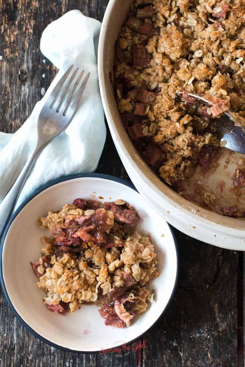 serving of Rhubarb Crumble beside the remaining dish