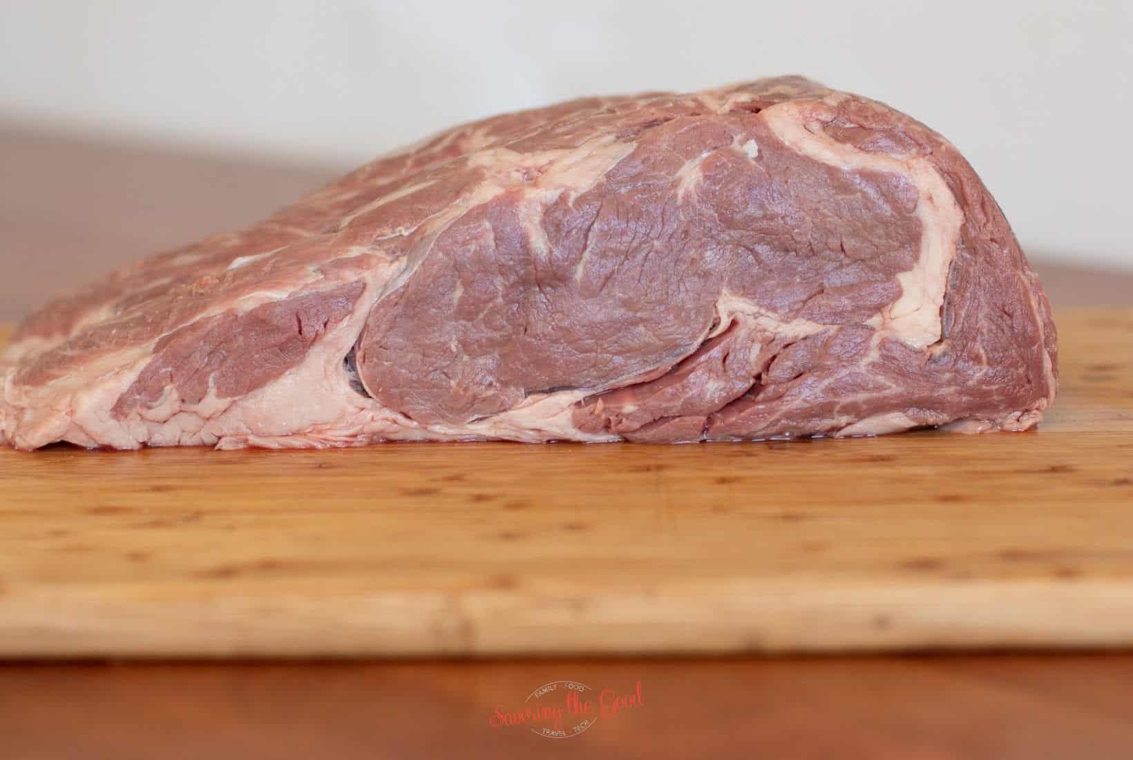 boneless rib roast on a cutting board