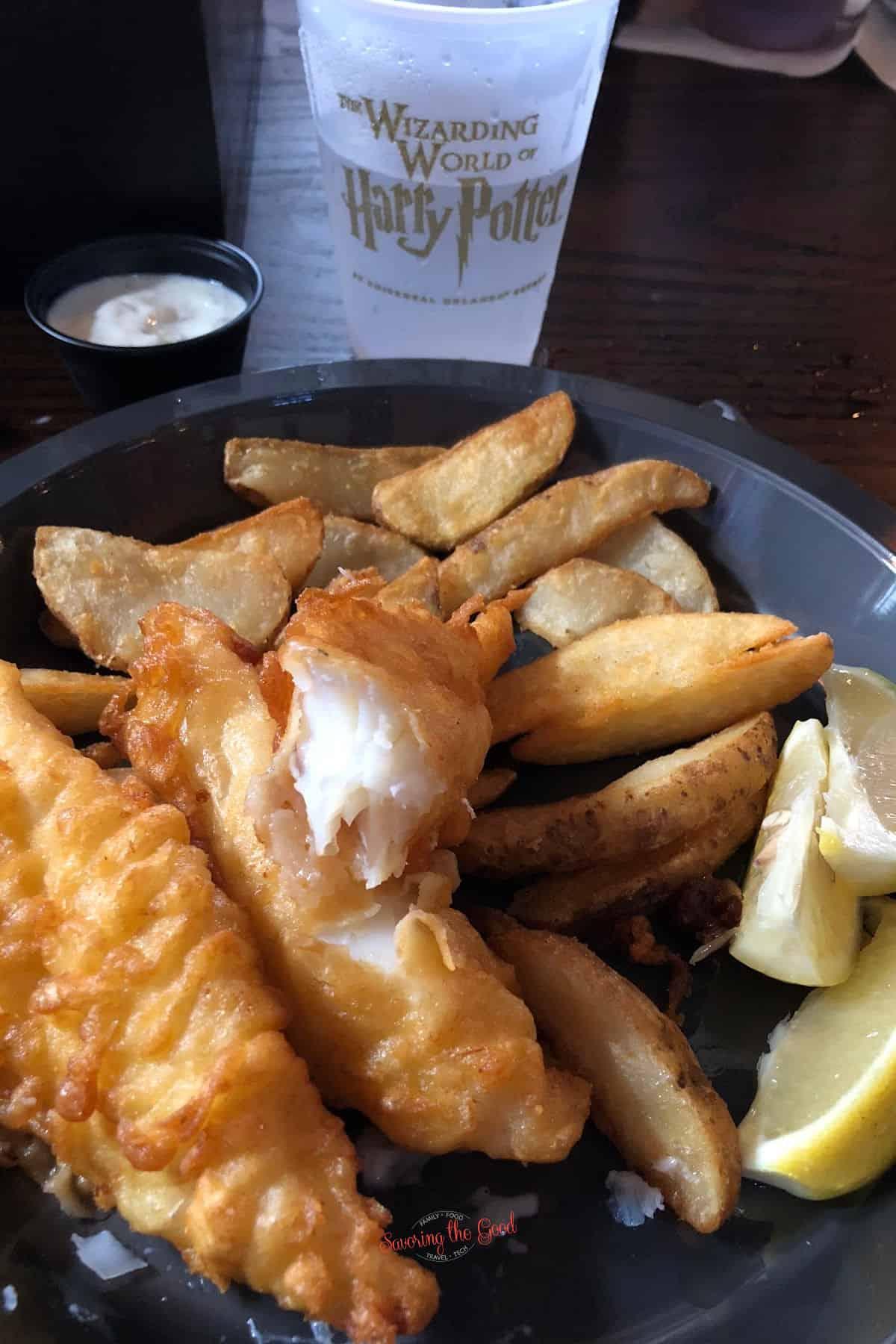 fish and chipp platter with lemon wedge garnish