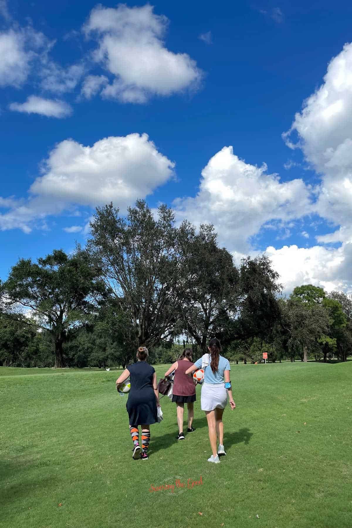trio of ladies walking on the walt disney world golf course to play footgolf