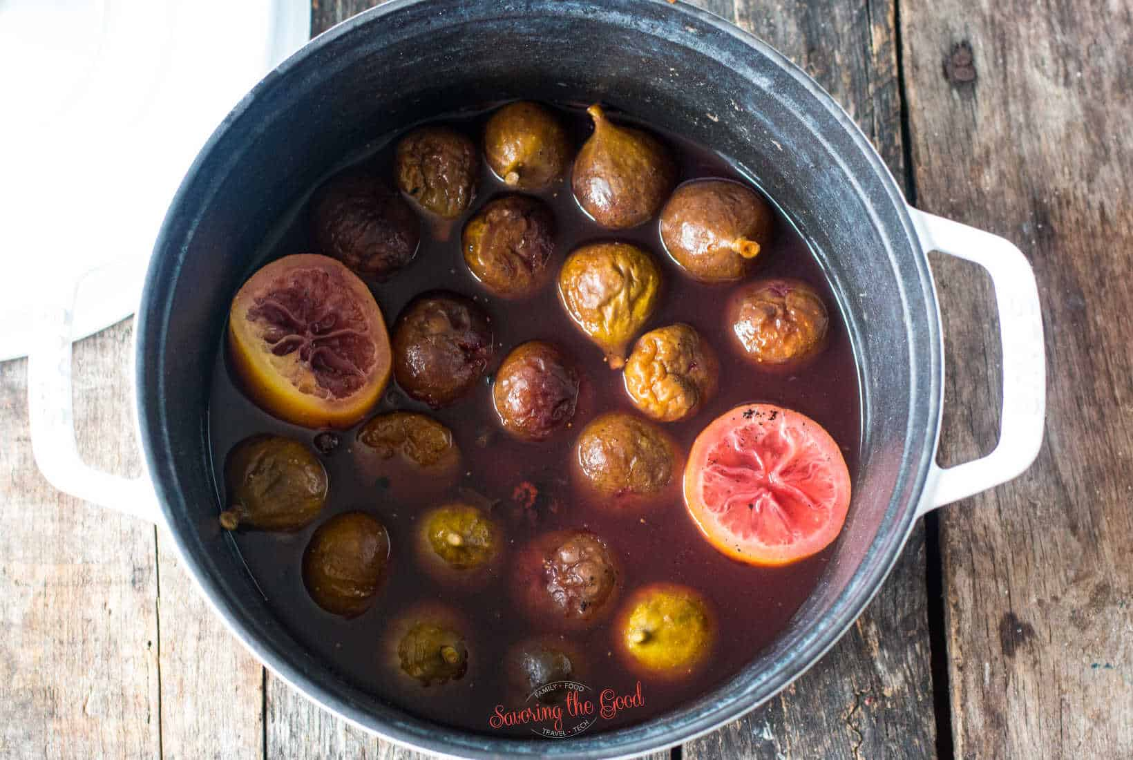 figs being poached in the syrup, showing the wrinkling of the figs