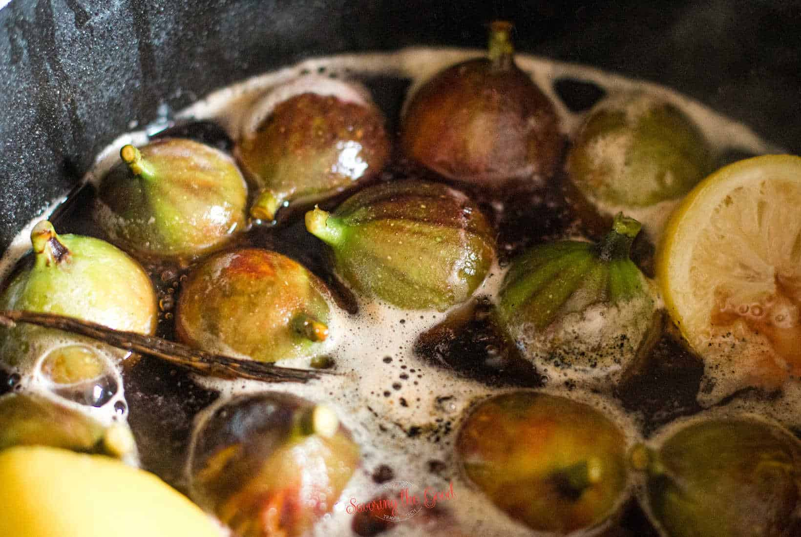 fresh figs in sugar syrup, starting to poach