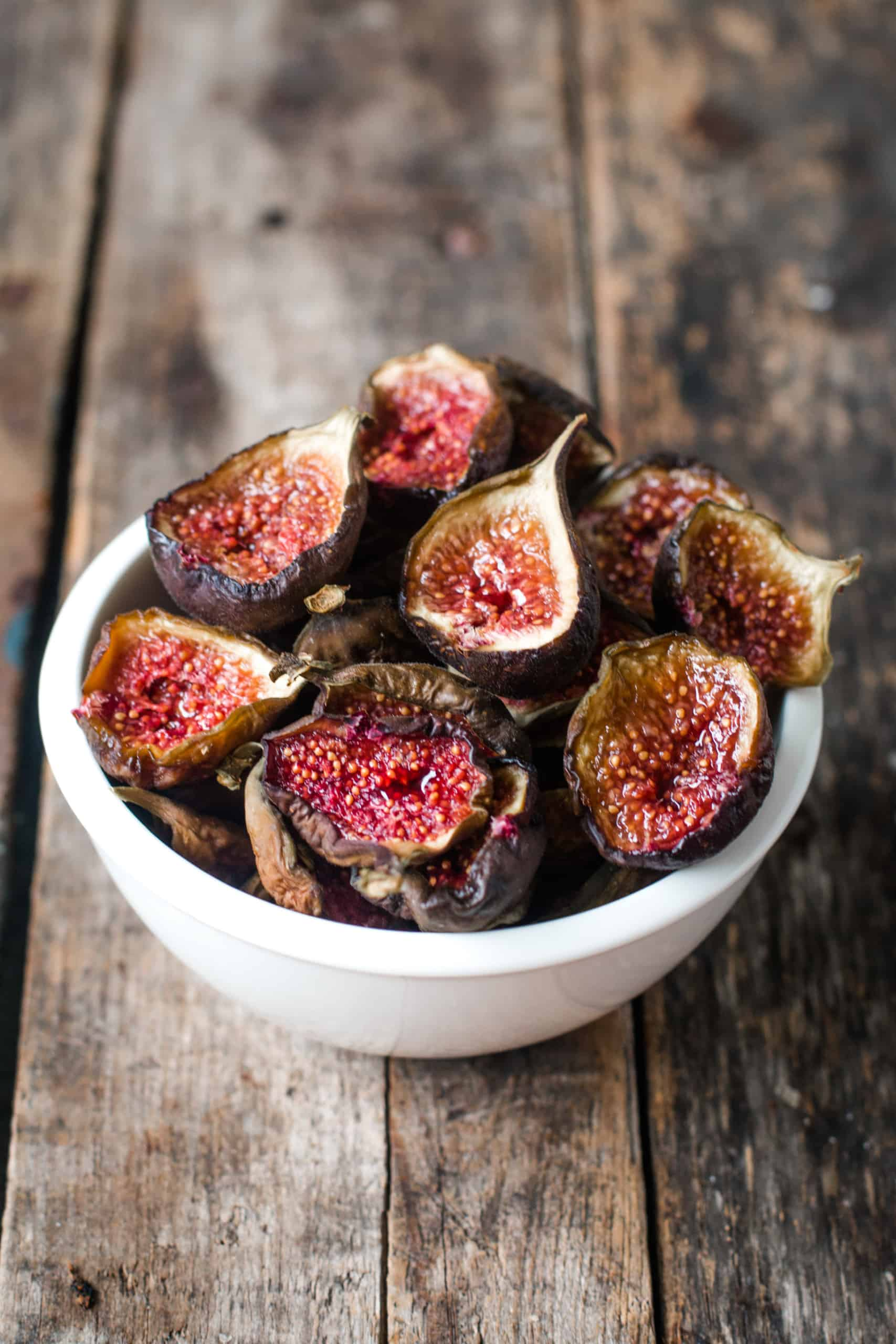 sliced open dried figs in a small white bowl