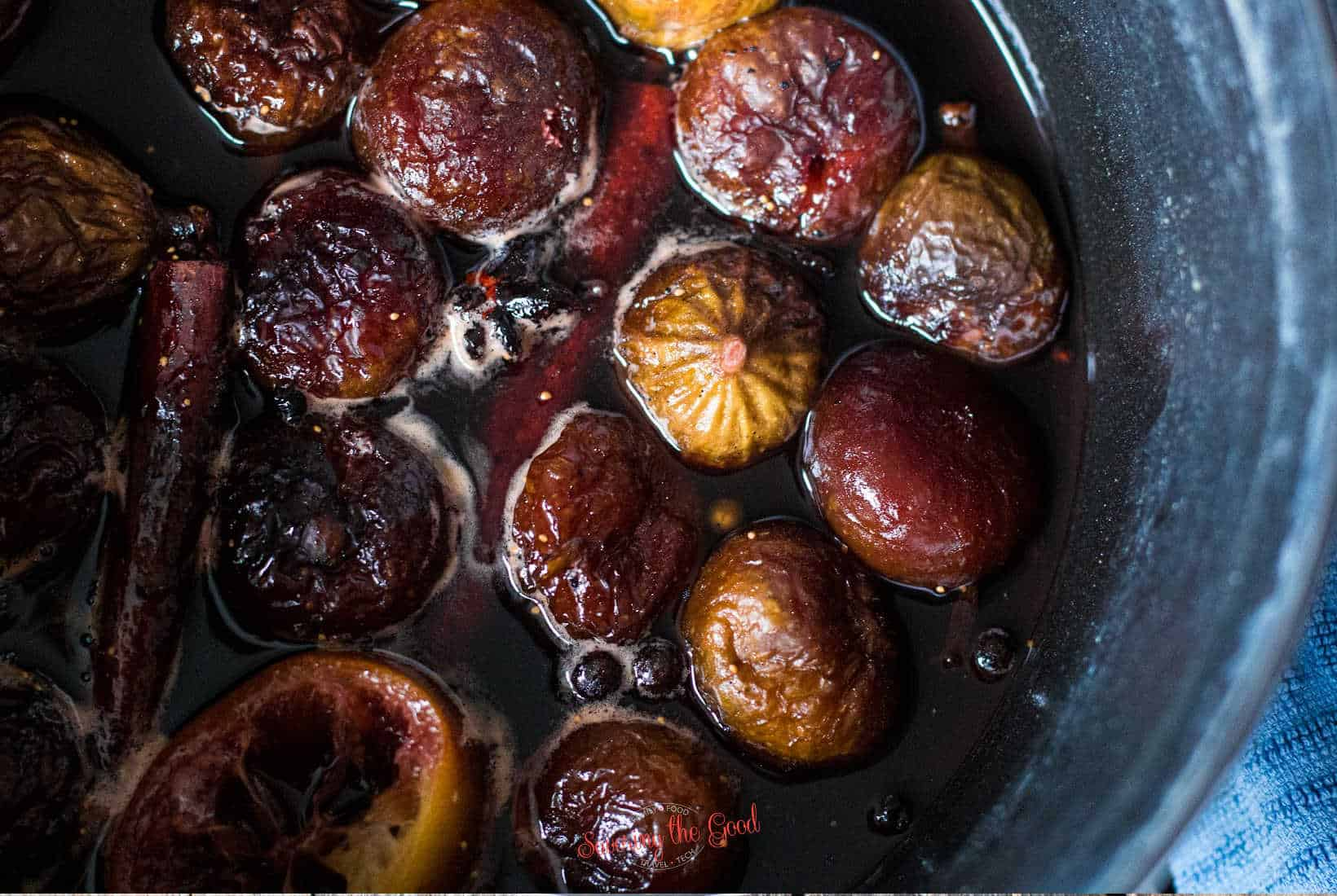 tight shot of figs being poached in a flavored simple syrup